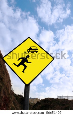 a warning sign about cars and pedestrians against a cloudy sky