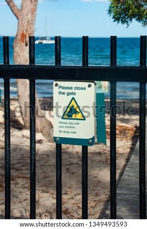 A warning sign detailing the dangers of Dingos on Fraser Island #1349493593