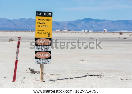 A warning sign in White Sands National Park keeping hikers away from a missile test range in New Mexico. Stock photo ©