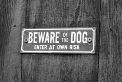 A warning sign which says beware of the dog