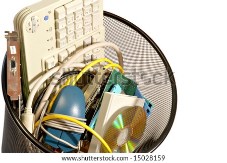 A wastebasket of old computer parts ready for the trash. File has clipping path to easily separate object from background.