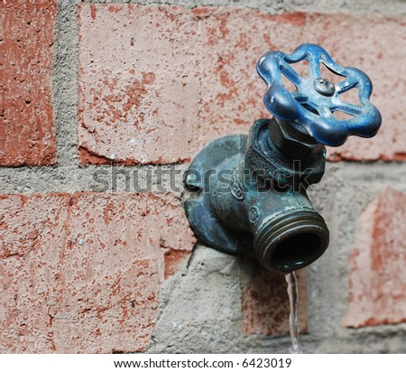 A water faucet of a suburban home