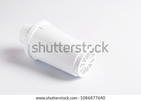 A water filter on a white background. #1086877640