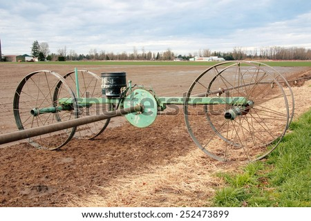 A water irrigation wheel and pump used to irrigate crops in Washington State/Water Irrigation Wheel and Mechanism/A water irrigation wheel and pump used to irrigate crops in Washington State.