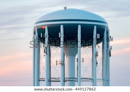 A Water tower in the deep blue sky background