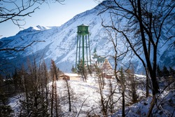 A water tower next to a historic hotel at Waterton Lakes National Park Canada.