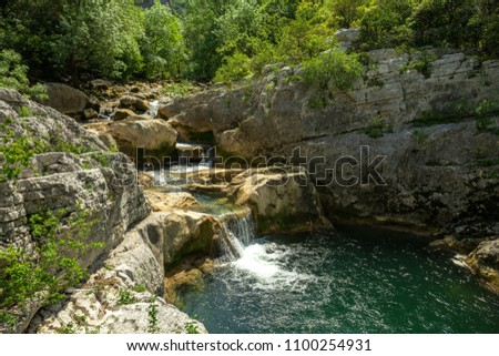 a waterfall and its wild green water in gorges of southern France #1100254931