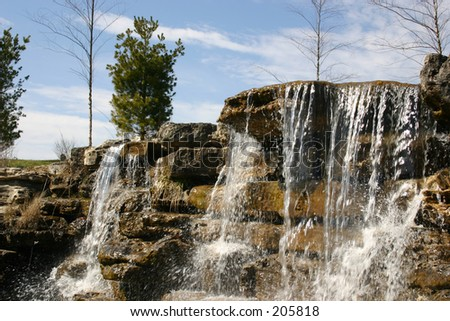A waterfall as the focal point in this landscaping job.