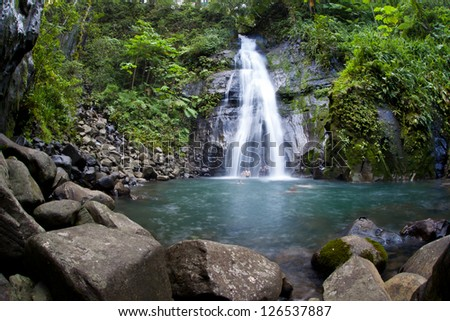 A waterfall cascades into a large pool on Cocos Island, Costa Rica.  Cocos is known for it large shark populations and great scuba diving.