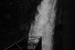 A waterfall immense amount of water falling from a cliff, Bandung