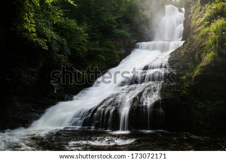 A waterfall in a forest.  Dingman's Falls, Delaware Water Gap National Recreation Area, PA, USA.