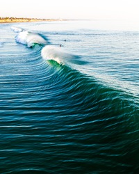 A wave about to barrel at the Oceanside Pier