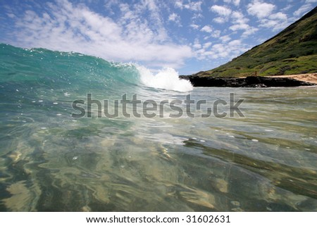a wave breaking close to shore