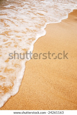 A wave breaking on the sand - Background texture
