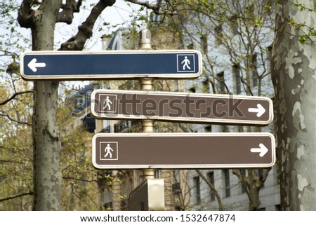 A 3-way directional sign (in Paris) for pedestrians with no text. Add your own texts or directions. This copy space is ideal for powerpoint presentation or something else visual with choices.