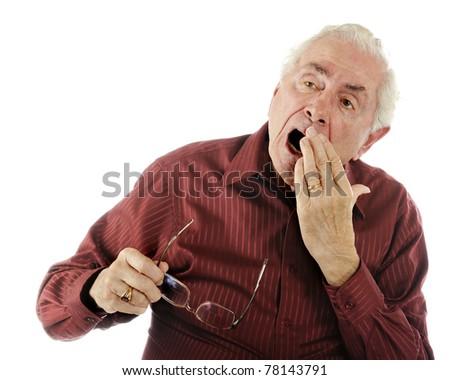 A weary senior man with a big yawn.