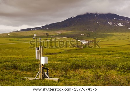 A weather monitor station sits in the tundra of the Canadian arctic near the arctic circle. #1377674375