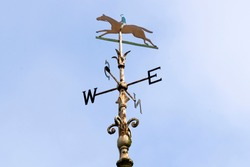 A weathercock (sign of the wind direction) with horse silhouette