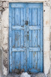 A weathered blue door on the island of Santorini, Greece, Europe