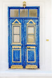 A weathered blue door on the island of Thassos, Greece, Europe