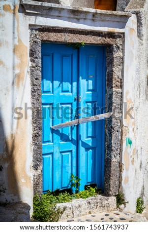A weathered Blue Greek Doorway on the Greek Island of Santorini