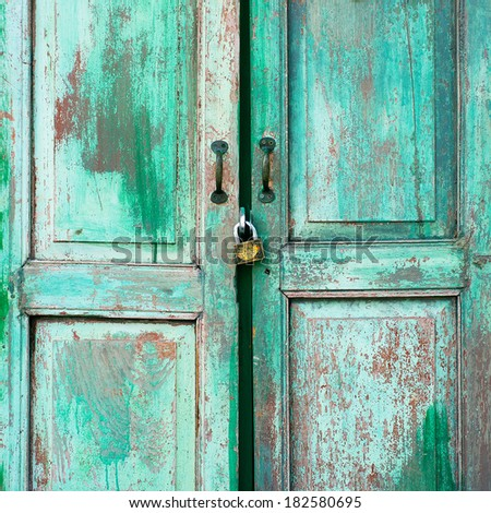 A weathered green door and old key vintage