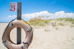 A weathered life preserver at a public beach access.