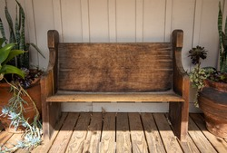 A weathered outdoor wooden bench.