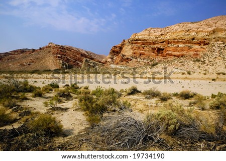 A weathered rock upthrust along a dry wash in Red Rock Canyon state park, California