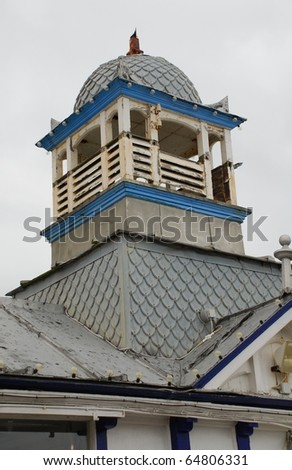 A weathered wooden turret on the Victorian pier at Eastbourne in East Sussex, England.