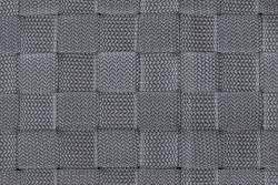 A weave pattern of silver-grey nylon home storage basket bin as a background