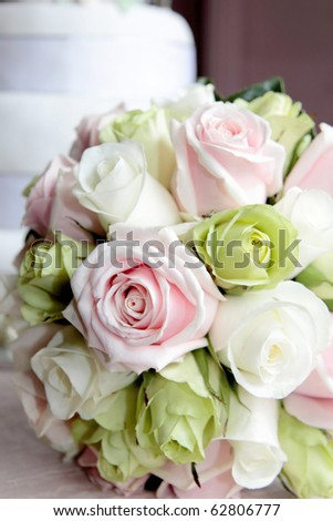 A wedding bouquet of pink and green roses.
