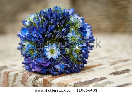 A wedding bouquet with Agapanthus (lily of the Nile), Nigella Damascena (love in a mist) and Hydrangea Macrophylla