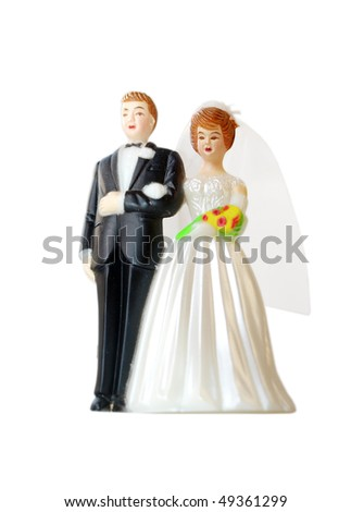 A wedding couple made of plastic, models for wedding cake, isolated on white background - stock photo