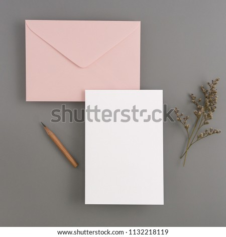 A wedding mock up concept. Wedding Invitation, envelopes, cards Papers on color background with ribbon and decoration. Top view, flat lay, copy space #1132218119