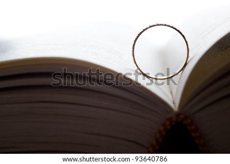 A wedding ring in a book.