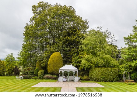 A wedding venue seen under a cloudy sky in Cheshire, England captured in May 2021. Сток-фото ©