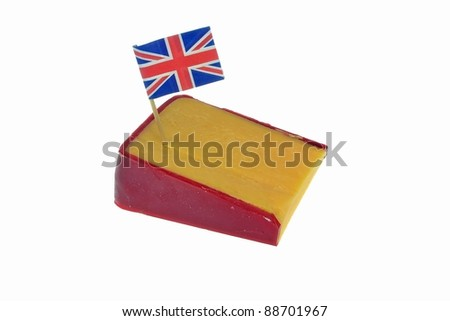 A wedge of cheddar cheese with British flag