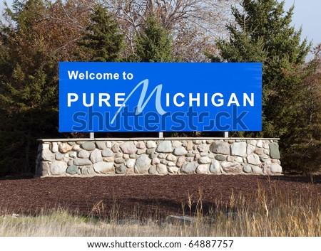A welcome sign at the Michigan state line. - stock photo