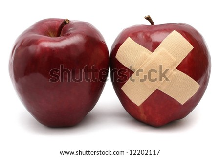 A well and good apple with a injured one.