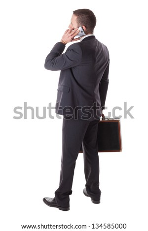 a well dressed businessman standing over a white background with a suitcase - stock photo