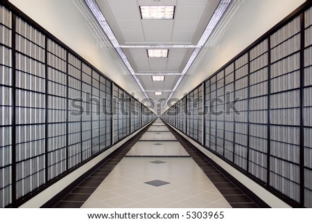 A well lit, infinite long hallway with po boxes - Symmetry. - stock photo