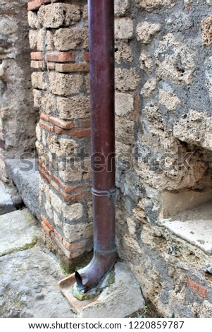 A well preserved lead pipe from within the ancient city of Pompeii, Italy, which was destroyed by the eruption of Mount Vesuvius volcano in 79AD.