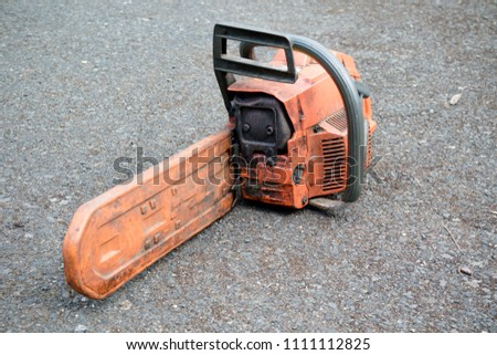 A well used chainsaw used by a tree surgeon #1111112825