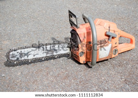 A well used chainsaw used by a tree surgeon #1111112834