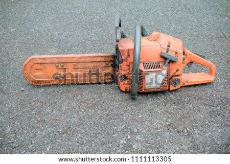 A well used chainsaw used by a tree surgeon #1111113305