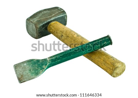 A well used hammer and chisel isolated on a white background