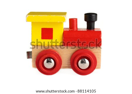 A well used toy train, isolated on a white background.
