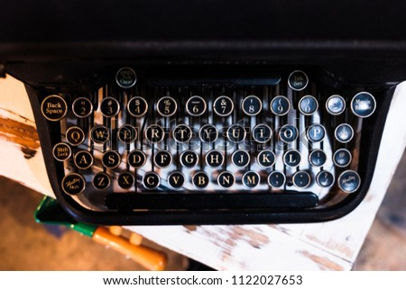 A well-used typewriter, used to write stories and has a few of its own. Still in great condition for its age! #1122027653
