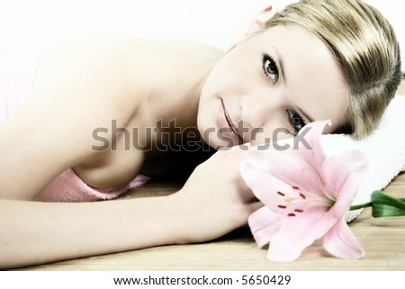 a wellness beauty portrait of a young woman with a flower